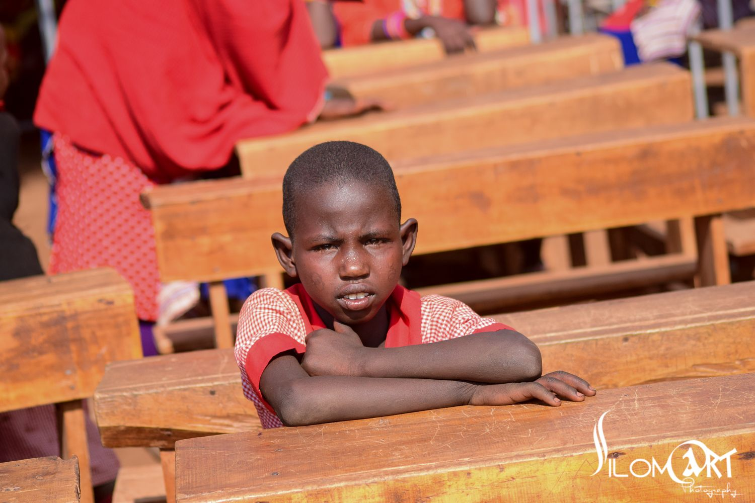 A Child Stares At The Ongoing Speech During The Launch Of The Esukuta Boma'S Borehole Project