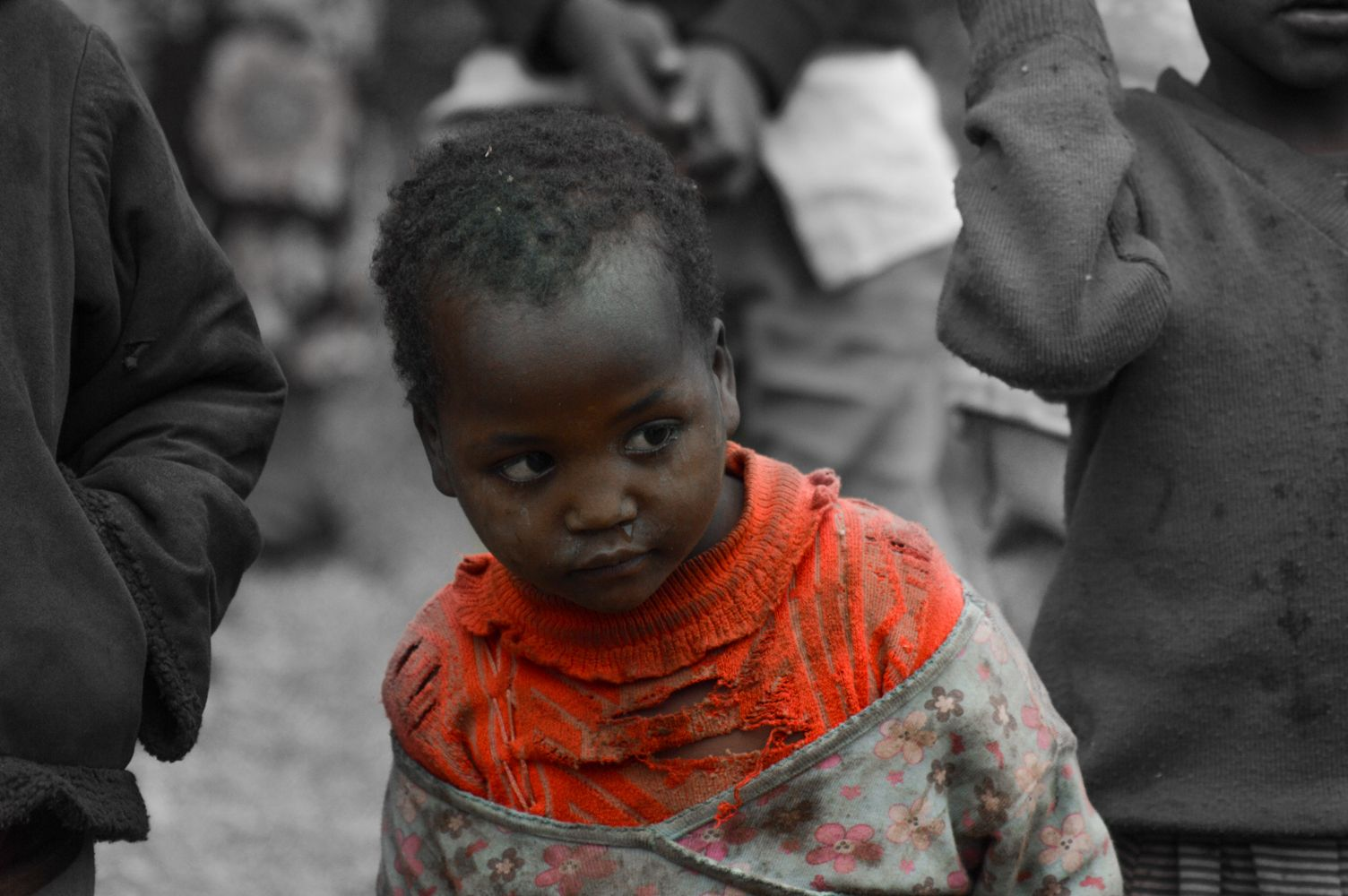 A Child Peeps, Awed By The Many Youth Who Came To The Aid Of Her Family