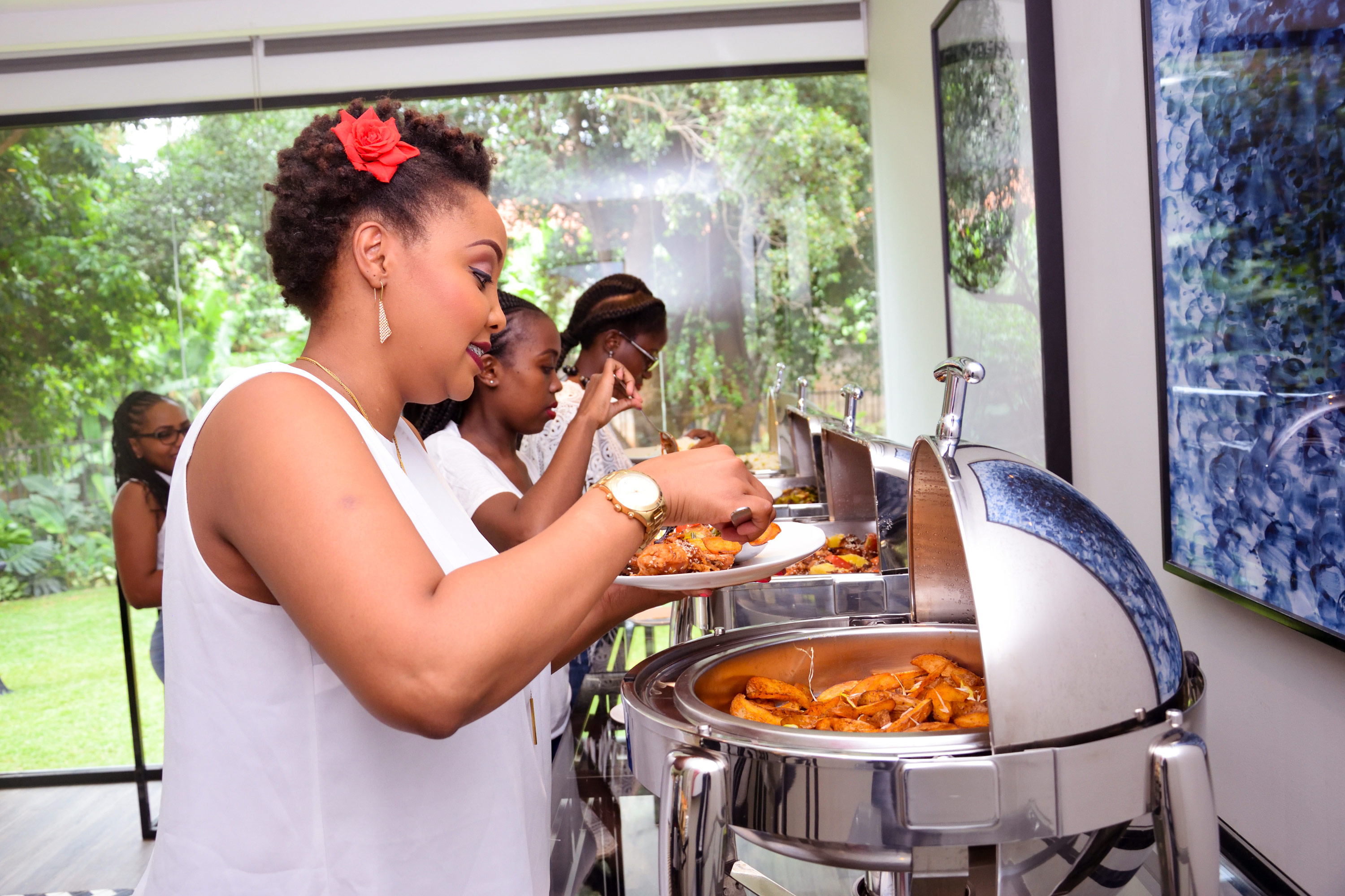 Ladies Serve Food At An Event