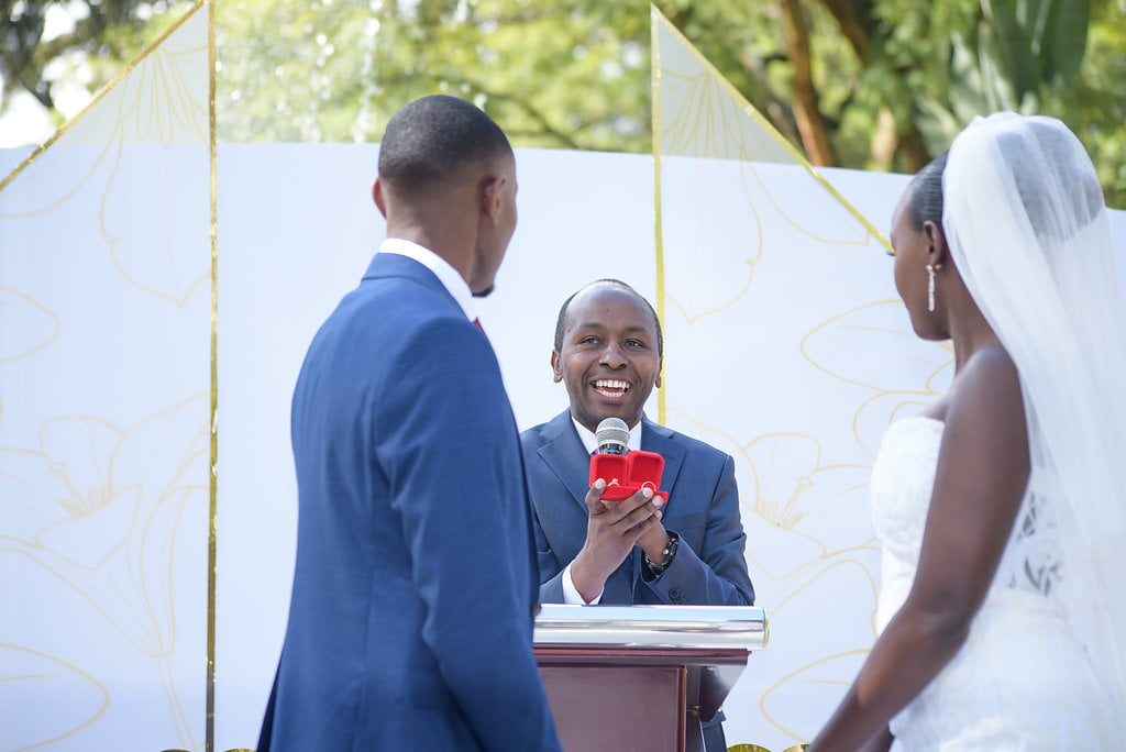 Pastor Smiles At The Bride And Groom